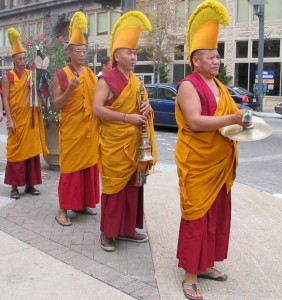 Tibetan Monks walk through downtown St. Louis on way to Mississippi river, photo by Linda Wiggen Kraft