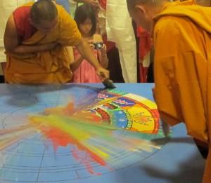 Tibetan Monks sweet sand into jar for dissolution of mandala, St. Louis, photo by Linda Wiggen Kraft
