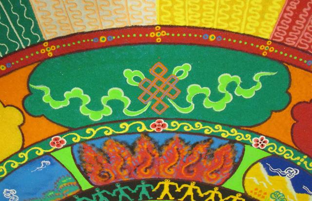 Tibetan sand mandala detail Endless Knot Auspicious Symbol photo by Linda Wiggen Kraft