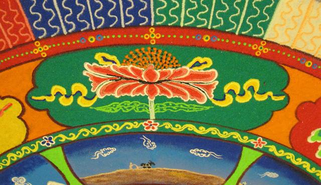 Tibetan sand mandala detail showing lotus auspicious symbol and earth element, photo by Linda Wiggen Kraft
