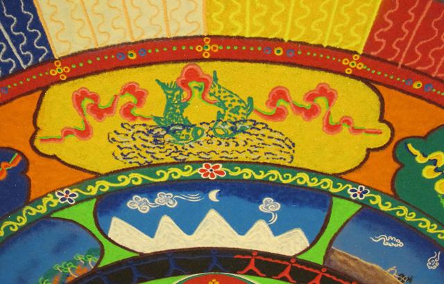 Tibetan sand mandala golden fish auspicious symbol and winter mountain scene, photo by Linda Wiggen Kraft