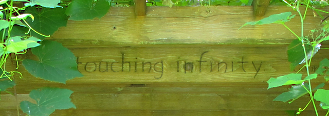 Quote by George Washington Carver about touching infinity inscribed into garden pergola designed by Linda Wiggen Kraft